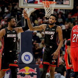 Dec 16, 2018; New Orleans, LA, USA; Miami Heat guard Dwyane Wade (3) celebrates with forward Derrick Jones Jr. (5) after a basket during the fourth quarter at the Smoothie King Center. Mandatory Credit: Derick E. Hingle-USA TODAY Sports
