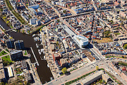 Nederland, Groningen, Groningen, 01-05-2013;<br /> Groningen-stad, centrum. Damsterdiep (Damsterplein met in het midden het nieuwe kantoor van Woningcorporatie Nijestee. Verder in beeld het Zuiderdiep en links de Oosterhaven (Eemskanaal) en de Oostersingel.<br /> View on the city of Groningen, old town.<br /> luchtfoto (toeslag op standard tarieven)<br /> aerial photo (additional fee required)<br /> copyright foto/photo Siebe Swart