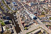 Nederland, Groningen, Groningen, 01-05-2013;<br /> Groningen-stad, centrum. Damsterdiep (Damsterplein met in het midden het nieuwe kantoor van Woningcorporatie Nijestee. Verder in beeld het Zuiderdiep en links de Oosterhaven (Eemskanaal) en de Oostersingel.<br /> View on the city of Groningen, old town.<br /> luchtfoto (toeslag op standard tarieven)<br /> aerial photo (additional fee required)<br /> copyright foto/photo Siebe Swart