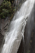 a rocky waterfall in the forest near the base of Franz Josef Glacier, New Zealand