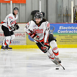 """FORT FRANCES, ON - Apr 30, 2015 : Central Canadian Junior """"A"""" Championship, game action between the Dryden GM Ice Dogs and the Fort Frances Lakers, game six of the Dudley Hewitt Cup. Marco Romano #14 of the Fort Frances Lakers skates with the puck during the second period.<br /> (Photo by Shawn Muir / OJHL Images)"""