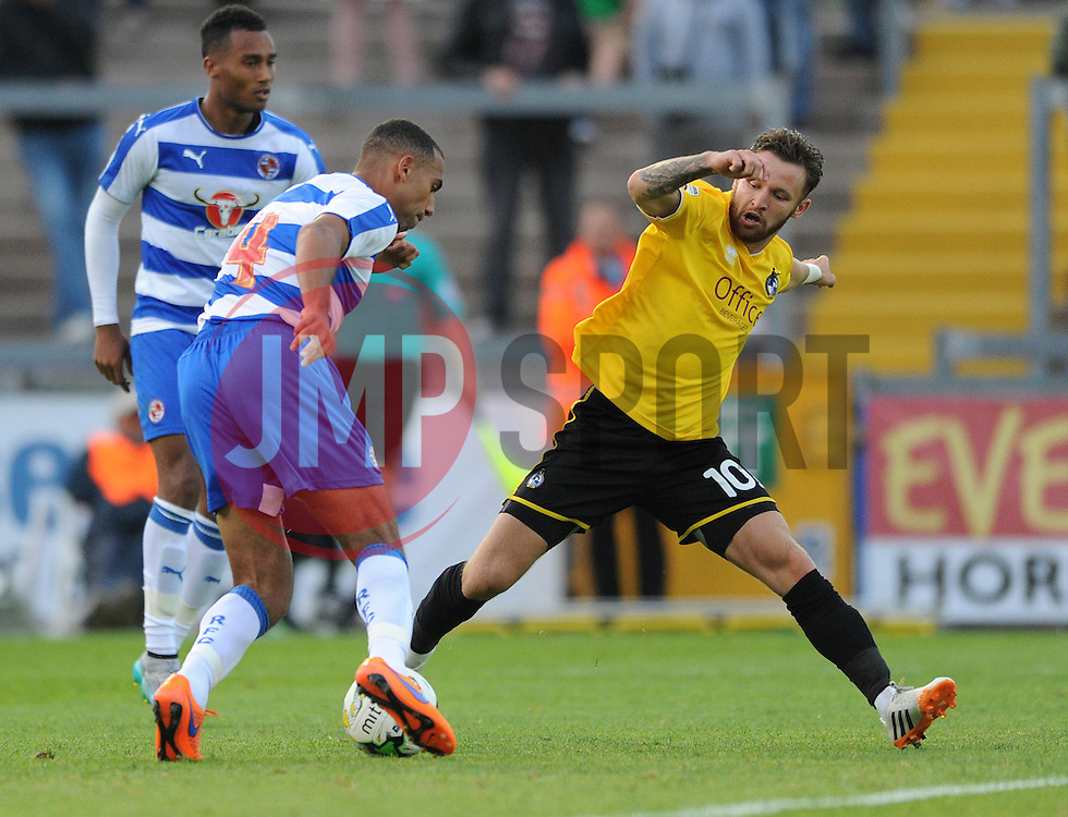 Matty Taylor of Bristol Rovers tackles Readings's Anton Ferdinand of Reading - Mandatory by-line: Dougie Allward/JMP - 21/07/2015 - SPORT - FOOTBALL - Bristol,England - Memorial Stadium - Bristol Rovers v Reading - Pre-Season Friendly