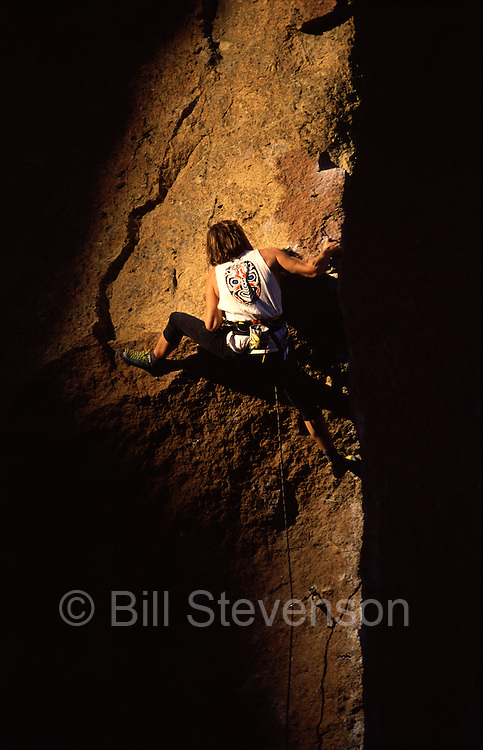 A picture of a man rock climbing at Smith Rock State Park in Oregon.