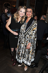 Left to right, NATALIE DORMER and LADY NAIPAUL at a dinner hosted by Pablo Ganguli and Ella Krasner to celebrate the 10th Anniversary of Liberatum and in honour of Sir Peter Blake held at The Corinthia Hotel, Nortumberland Avenue, London on 23rd November 2011.