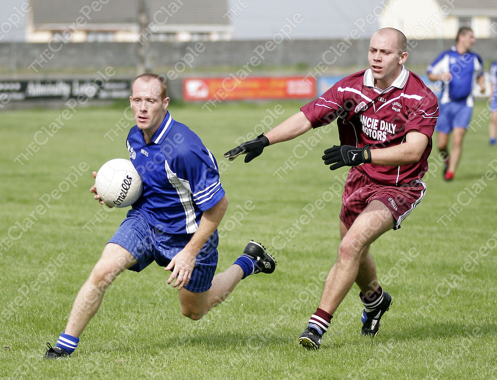 Kilballyowen's Michael Liddane holds posession despite the pressure of Lissycasey's Brendan McNamara in Quilty on Saturday.<br />