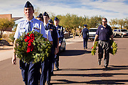 09 DECEMBER 2011 - PHOENIX, AZ:  Master Sgt DAVID MATTESON leads members of the Civil Air Patrol through the National Cemetery in Phoenix to lay Christmas wreaths on veterans' graves. Several hundred volunteers and veterans gathered at the National Memorial Cemetery of Arizona in Phoenix Saturday to lay Christmas wreaths on headstones, a tradition started by Wreaths Across America. Wreaths Across America is a nonprofit organization founded to continue and expand the annual wreath laying ceremony at Arlington National Cemetery begun by Maine businessman, Morrill Worcester, in 1992.   PHOTO BY JACK KURTZ
