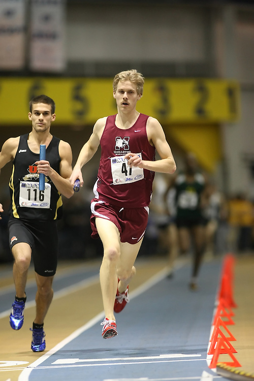 Windsor, Ontario ---13/03/09--- Andrew Douglas of  McMaster University competes in the 4x800m Relay at the CIS track and field championships in Windsor, Ontario, March 13, 2009..Sean Burges Mundo Sport Images