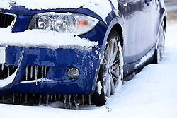 © Licensed to London News Pictures. 12/03/2013, Hayward Heath, UK.  A car is seen abandoned by a snow covered road side near Hayward Heath, West Sussex, England, as roads are affected by snow fall, Tuesday, March 12, 2013. Photo credit : Sang Tan/LNP