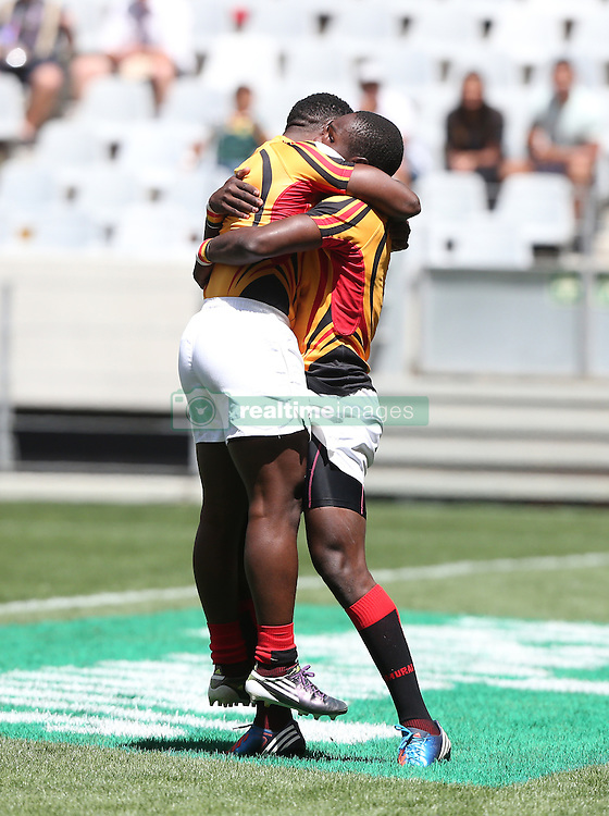 Uganda celebrate a try during the HSBC Cape Town Sevens tournament held at the Cape Town Stadium in Cape Town on the 10th December 2016<br /> <br /> Photo by: Luke Walker / RealTime Images