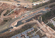 aerial photograph showing construction of the new Railway Bridge and canal aqueduct over the Selly Oak Bypass / A38 / Aston Webb Boulevard in Birmingham England Great Britain. In a major feat of civil engineering the massive railway bridge was built off line and then moved into position.