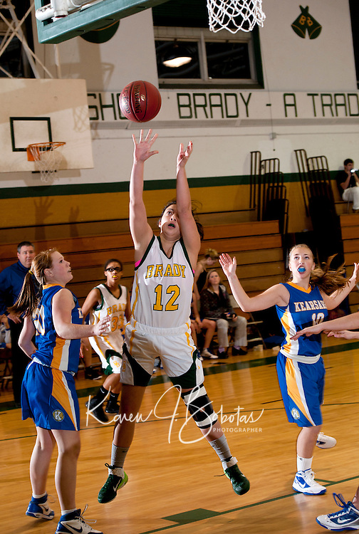 Bishop Brady's Taylor Ong takes a shot during Monday nights matchup against Kearsarge High School.  (Karen Bobotas/for the Concord Monitor)