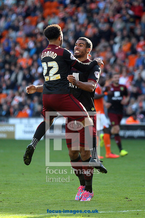 Lewis Grabban of Norwich scores his sides 2nd goal and celebrates during the Sky Bet Championship match at Bloomfield Road, Blackpool<br /> Picture by Paul Chesterton/Focus Images Ltd +44 7904 640267<br /> 27/09/2014