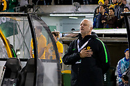 CANBERRA, AUSTRALIA - OCTOBER 10: Australian coach Graham Arnold  sings the national anthem at the FIFA World Cup Qualifier soccer match between Australia and Nepal on October 10, 2019 at GIO Stadium in Canberra, Australia. (Photo by Speed Media/Icon Sportswire)
