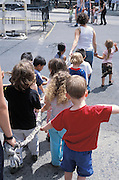 children on there way to a park holding a rope