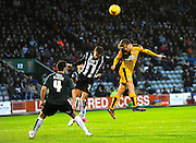 Plymouth Argyle's Carl McHugh, Plymouth Argyle's Gary Sawyer and Cambridge Utd's Luke Berry during the Sky Bet League 2 match between Plymouth Argyle and Cambridge United at Home Park, Plymouth, England on 12 December 2015. Photo by Graham Hunt.