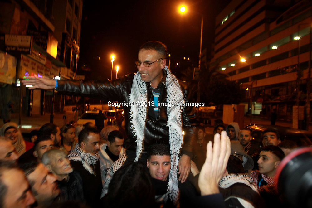 60875570<br /> A newly released Palestinian prisoner is greeted by relatives and friends upon his arrival in the West Bank city of Nablus, on Dec. 31, 2013. Israel freed 26 Palestinian prisoners early Tuesday, as part of a U.S.-brokered agreement to resume direct peace talks between the two sides, Tuesday, 31st December 2013. Picture by  imago / i-Images<br /> UK ONLY