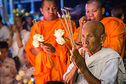 02 FEBRUARY 2013 - PHNOM PENH, CAMBODIA: Cambodians pray for former King Norodom Sihanouk at a small shrine in Phnom Penh. Much of Phnom Penh has been shut down to honor former King Norodom Sihanouk, who ruled Cambodia from independence in 1953 until he was overthrown by a military coup in 1970. Only bars, restaurants and hotels that cater to foreign tourists are supposed to be open. The only music being played publicly is classical Khmer music. Sihanouk died in Beijing, China, in October 2012 and will be cremated during a state funeral royal ceremony on Monday, Feb. 4.     PHOTO BY JACK KURTZ