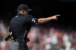SAN FRANCISCO, CA - MAY 02:  MLB umpire Adam Hamari #78 signals from behind home plate during the eighth inning between the San Francisco Giants and the Los Angeles Angels of Anaheim at AT&T Park on May 2, 2015 in San Francisco, California.  The San Francisco Giants defeated the Los Angeles Angels of Anaheim 5-4. (Photo by Jason O. Watson/Getty Images) *** Local Caption *** Adam Hamari
