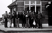 Under 16 football team meet up ready to travel to a match. London, UK, 1980s.