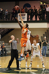 01 March 2014:  Nate Haynes & Victor Davis begin the action with the tip off during an NCAA mens division 3 CCIW  Championship basketball game between the Wheaton Thunder and the Illinois Wesleyan Titans in Shirk Center, Bloomington IL