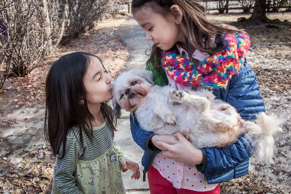 """Sharkey is 17 years old and going down hill quickly.  We wanted some photographs of her with the kids.""  -Meghan Kim and her daughters Kisun and Minsun, Anchorage"
