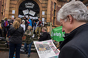 A local resident reads about the campaign aginst the closure by Lambeth council of Carnegie Library in Herne Hill, south London as protesters remain inside the premises on day 3 of its occupation, 3rd April 2016. The angry local community in the south London borough have occupied their important resource for learning and social hub for the weekend. After a long campaign by locals, Lambeth have gone ahead and closed the library's doors for the last time because they say, cuts to their budget mean millions must be saved. A gym will replace the working library and while some of the 20,000 books on shelves will remain, no librarians will be present to administer it.