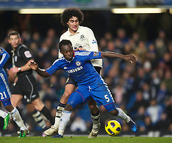 LONDON, ENGLAND - Saturday, December 4, 2010: Everton's Marouane Fellaini and Chelsea's Michael Essien during the Premiership match at Stamford Bridge. (Pic by: David Rawcliffe/Propaganda)