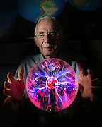 Inside his office Arthur Rosenfeld holds a plasma energy ball. Arthur Rosenfeld, a nuclear physicist-turned-father-of-energy-efficiency. Rosenfeld spent much of his career as a research physicist; now he's squarely in the field of policy as a state energy commissioner, and an influential voice in the battle against climate change. This month, Rosenfeld turns 80. The day before his birthday, he will travel to Washington DC to pick up the Enrico Fermi award, the federal government's oldest award for scientific achievement. Picture taken May 31, 2006. Sacramento Bee Bryan Patrick.BLUE PLATE SPECIAL