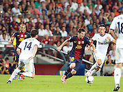Lionel Messi attacks for Barcelona taking on Mesmut Ozil of Real Madrid.  Barcelona v Real Madrid, Supercopa first leg, Camp Nou, Barcelona, 23rd August 2012...Credit - Eoin Mundow/Cleva Media.