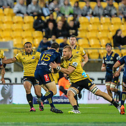 Ben Smith (CC) tackled during the super rugby union  game between Hurricanes  and Highlanders, played at Westpac Stadium, Wellington, New Zealand on 24 March 2018.  Hurricanes won 29-12.