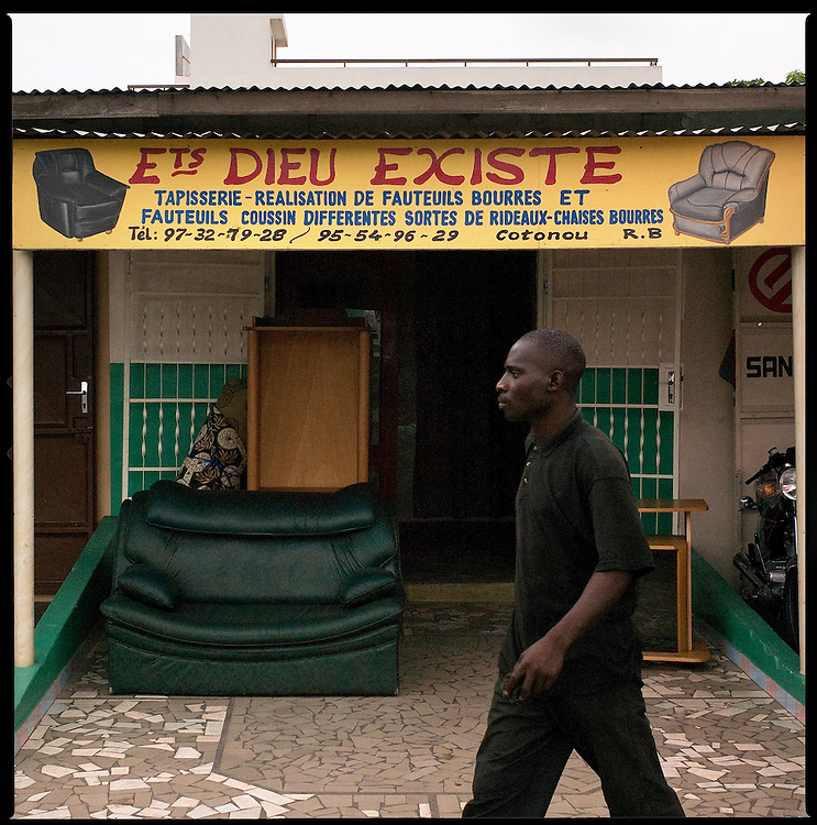 April 2008 - In Africa, and particularly in Benin, the relationship between people and God is very close. .They like to write quotations from the Bible or proverbs either on their motorbikes or on the names of stores. One way for them to be protected from evil eye.©Jean-Michel Clajot
