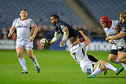 Viliame Mata (#8) of Edinburgh Rugby looks to offload a pass as he is tackled by Marcell Coetzee (#8) of Ulster Rugby during the Guinness Pro 14 2018_19 match between Edinburgh Rugby and Ulster Rugby at the BT Murrayfield Stadium, Edinburgh, Scotland on 12 April 2019.