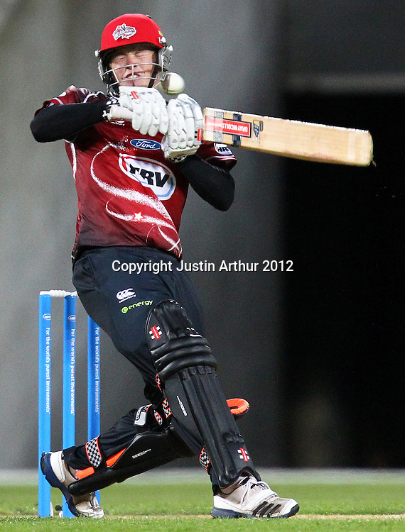 Wizards' Henry Nicholls plays a shot during the 2012/2013 HRV Cup Twenty20 session. Wellington Firebirds v Canterbury Wizards at Westpac Stadium, Wellington, New Zealand on Friday 9 November 2012. Photo: Justin Arthur / photosport.co.nz