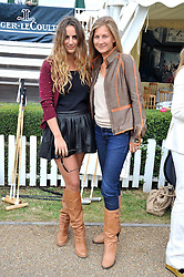 Left to right, ALEXIA NIEDZIELSKI and ELIZABETH VON GUTTMAN at a charity polo match organised by Jaeger Le Coultre was held at Ham Polo Club, Richmond, Surrey on 12th June 2009.