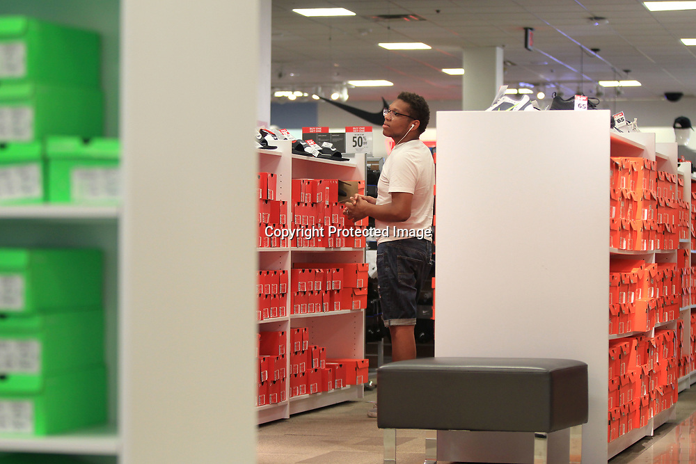 Jessie Reed, of Tupelo, looks for a couple of pairs of shoes at JCPenny at the Mall at Barnes Crossing.