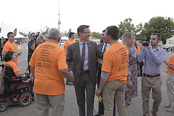 The 53rd Annual Kentucky Farm Beureau Country Ham Breakfast was protested by Congressman John Yarmuth, Chris Hartman and other members of various fairness organizations outside the South Wing of the Kentucky Fair and Exposition Center, Thursday, Aug. 25, 2016 in Louisville.