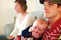 Brian Longwell holds his six-month-old son Tayler at his Coeur d'Alene home Friday with his wife Nikki. The Longwells adopted Tayler at birth through the Idaho Youth Ranch.