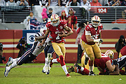 San Francisco 49ers quarterback Colin Kaepernick (7) scrambles from the New England Patriots defense at Levi's Stadium in Santa Clara, Calif., on November 20, 2016. (Stan Olszewski/Special to S.F. Examiner)