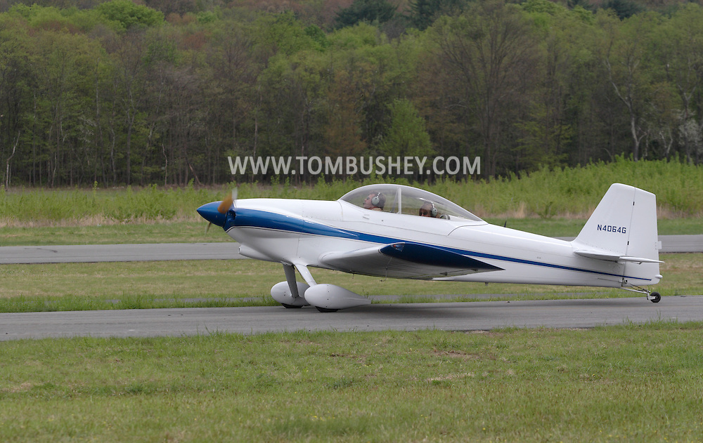 Wurtsboro, NY - A pilot and passenger in a 2001 Mullaney Robert S RV-4 taxi down the runway at the grand reopening of Wurtsboro Airport on May 11, 2008.