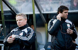 NEWCASTLE, ENGLAND - Sunday, December 28, 2008: Liverpool's assistant manager Sammy Lee and goalkeeping coach Xavi Valero with a telephone link to absent manager Rafael Benitez who continues to recover from surgery during the Premiership match against Newcastle United at St James' Park. (Photo by David Rawcliffe/Propaganda)