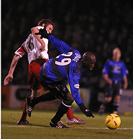 Photo: Jo Caird<br /> Gillingham v Sheffield United<br /> Priestfield Stadium<br /> Nationwide Div One 2004<br /> 10/01/2004.<br /> <br /> MAMADY SIDIBE PLAYS THE BALL IN FRONT OF MICHEAL TONGE