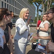 WASHINGTON,DC-JUL13: Isabella Gelfand, a student at Wellesley College who is interning at the Feminist Majority Foundation this summer, reaches out to shake  Senator Kirsten Gillibrand's hand, at a rally for survivors of sexual assault and their allies, outside the Department of Education, ahead of a series of meetings that Secretary Betsy DeVos is holding with survivors, advocates for the wrongly accused and college administrators. DeVos is considering whether to rollback Obama-era guidance on handling sexual assault, which victims' advocates credit with improving the situation on college campuses, and which others say has led schools to err on the side of finding students guilty of assault even when they are innocent. (Photo by Evelyn Hockstein/For The Washington Post)