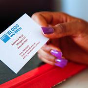 Rushama Venus Mcgill, a graduate of the 10,000 Women Program, shares her business card. Monrovia, Liberia, April 2012.