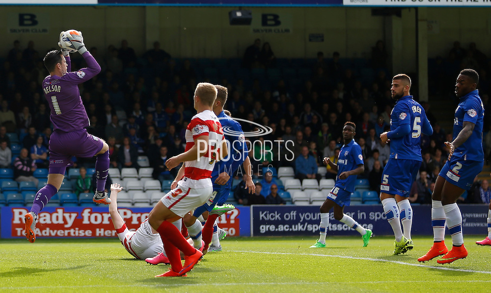 Stuart Nelson claims a dangerous looking ball in to the box during the Sky Bet League 1 match between Gillingham and Doncaster Rovers at the MEMS Priestfield Stadium, Gillingham, England on 5 September 2015. Photo by Andy Walter.
