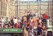 Ravers cheering from their truck, 2nd Criminal Justice March, Parliament Buildings, London, UK, 23rd July 1994.