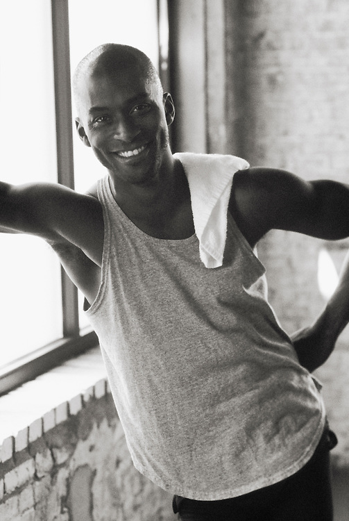 Black and White Portrait of a smiling mid 30's African American man after a workout at a health club.<br />