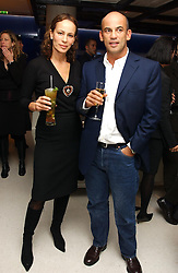 GUY & ANDREA DELLAL at a dinner hosted by Cartier to celebrate the opening of the 2004 Frieze Art Fair, held at Yauacha 15-17 Broadwick Street, London W1 on 13th October 2004.<br />