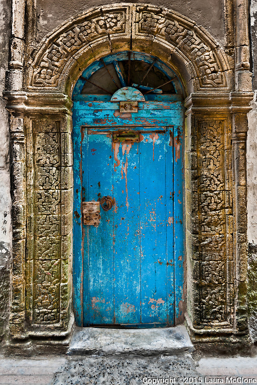 Vintage Blue Moroccan Doorway with carved stone surround, Essaouira Morocco
