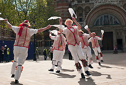 © Licensed to London News Pictures. 12/05/2012, London, UK.  Thaxted Morris Men dance outside the Westminster Cathedral in London as Morris men from around the country gather in London for a Westminster Morris Men Day of Dance, Saturday, May 12, 2012. Photo credit : Sang Tan/LNP