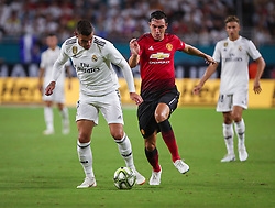 July 31, 2018 - Miami Gardens, Florida, USA - Real Madrid C.F. defender Theo Hernandez (15) (left) competes for the ball with Manchester United F.C. defender Matteo Darmian (36) (right)  during an International Champions Cup match between Real Madrid C.F. and Manchester United F.C. at the Hard Rock Stadium in Miami Gardens, Florida. Manchester United F.C. won the game 2-1. (Credit Image: © Mario Houben via ZUMA Wire)